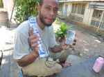 Peri and his phone battery in Port Moresby